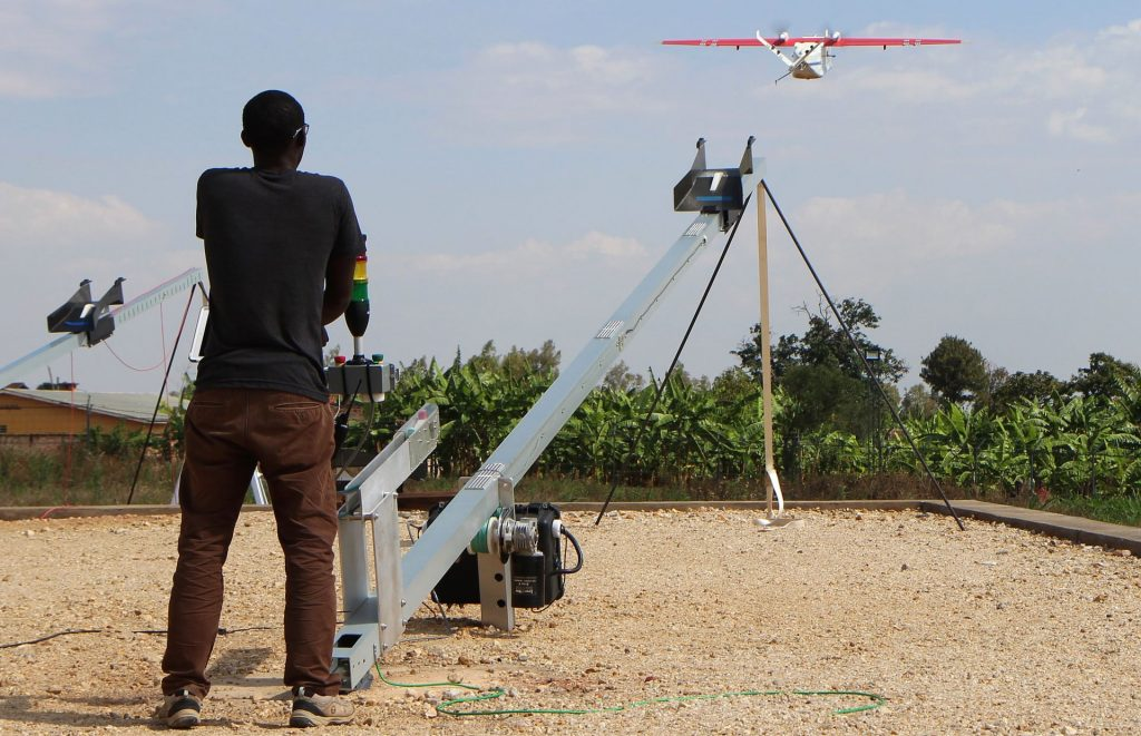 A Zipline worker technician launches a drone in Muhanga. Photograph: Stephanie Aglietti/AFP/Getty Images