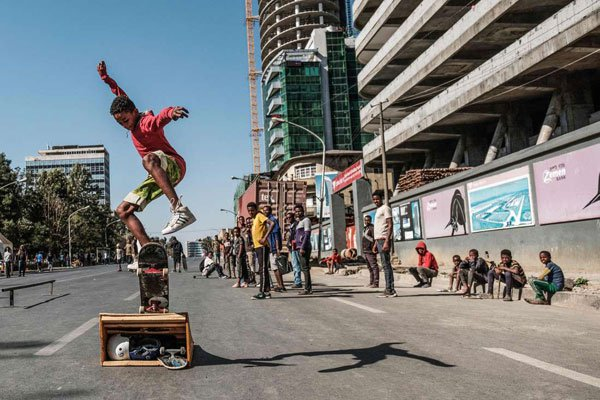 A skateboarder performs on a street in Addis Ababa on February 3, 2019 during the third Car Free Day. [PHOTO | EDUARDO SOTERAS | AFP]